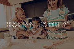 Woman with Tablet. Happy Family Enjoy Cooking. Girl Hold Rolling Pin. Girl Knead Dough. Grandmother Help Girl. Happy Family Cooking. Child Make Cookies royalty free stock photo