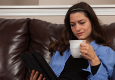 Woman with a tablet Stock Images
