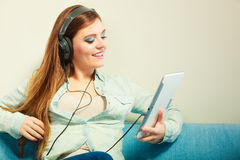 Woman with tablet headphones relaxing Stock Images