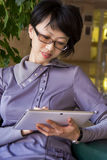 Woman and tablet Royalty Free Stock Image