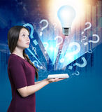 Woman with tablet and light bulb Stock Photos