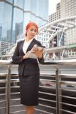 Woman with tablet at modern city Stock Photography