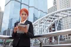 Woman with tablet at modern city Royalty Free Stock Photos