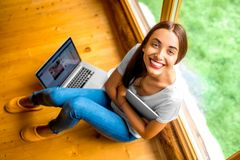 Woman with tablet near the window in cottage Royalty Free Stock Image