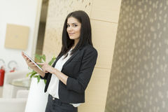 Woman with tablet in the office Royalty Free Stock Photos