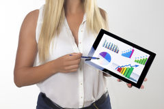 Woman with tablet in office. Young  woman working with tablet in office Stock Photos
