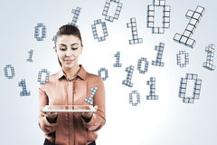 Woman with tablet and ones and zeros Stock Images