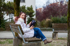 Woman with tablet outdoor Stock Photo
