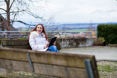 Woman with tablet outdoor Royalty Free Stock Image