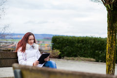 Woman with tablet outdoor Royalty Free Stock Photos