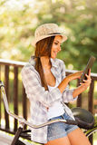 Woman tablet outdoors Stock Photography