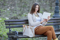 Woman with tablet in the park Stock Photo