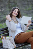 Woman with tablet in the park Royalty Free Stock Photos