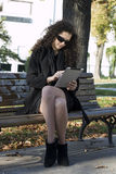 Woman and tablet PC Stock Images