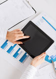 Woman with tablet pc and chart papers Royalty Free Stock Photography