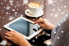 Woman with tablet pc and coffee cup Royalty Free Stock Photography