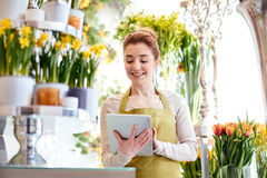 Woman with tablet pc computer at flower shop Stock Photo