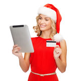 Woman with tablet pc and credit card Stock Photo