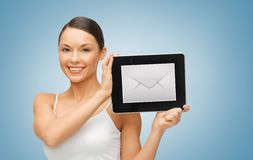 Woman with tablet pc and envelope icon. Picture of beautiful woman with tablet pc and envelope icon Royalty Free Stock Photography
