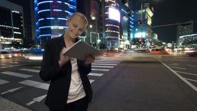 Woman with tablet PC in night Seoul, South Korea Royalty Free Stock Photography