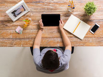 Woman with tablet pc and notebook at office table Royalty Free Stock Images