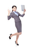 Woman with Tablet PC and ok hand sign Royalty Free Stock Images