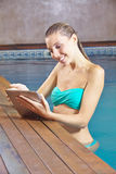 Woman with tablet PC in swimming Royalty Free Stock Images