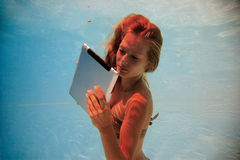 Woman with tablet PC underwater Stock Images
