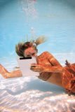 Woman with tablet PC underwater Royalty Free Stock Photos