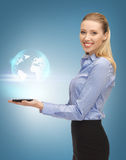 Woman with tablet pc and virtual earth Royalty Free Stock Image