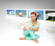 Woman with tablet pc and virtual screens Royalty Free Stock Photos