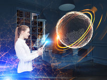 Woman with a tablet, polygonal orb Royalty Free Stock Photo