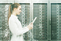 Woman with a tablet in a server room Stock Photography