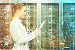 Woman with a tablet in a server room toned Royalty Free Stock Photos