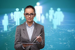 The woman with tablet in social networks concept Stock Photo
