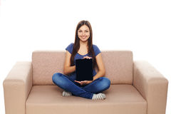 Woman with tablet on sofa Stock Image
