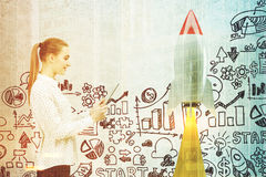 Woman with a tablet, startup rocket toned Stock Images