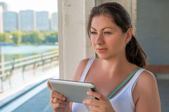 Woman with a tablet in urban locations Stock Image