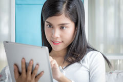 Woman On Tablet Stock Images