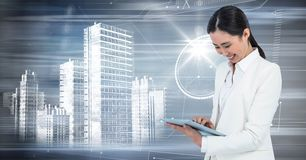 Woman with tablet and white building graphic against motion blur. Digital composite of Woman with tablet and white building graphic against motion blur Stock Photos