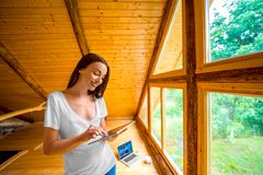Woman with tablet in the wooden house Royalty Free Stock Images