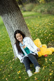 Woman with taddy-bear at park Royalty Free Stock Images