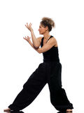Woman tai chi. Mature woman praticing tai chi chuan in studio on isolated white background royalty free stock photo
