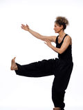 Woman tai chi. Mature woman praticing tai chi chuan in studio on isolated white background royalty free stock images