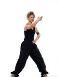 Woman tai chi. Mature woman praticing tai chi chuan in studio on isolated white background royalty free stock image