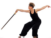 Woman tai chi. Mature woman praticing tai chi chuan with sword in studio on isolated white background Stock Image
