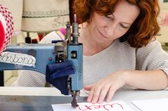 Woman tailor, fabric sewing, female sewing