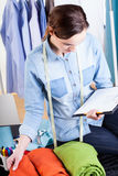 Woman tailor checking a fabric Stock Image
