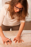 Woman tailor cutting textile in craft workshop Royalty Free Stock Image