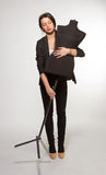 Woman tailor holding on Mannequin Stock Photo